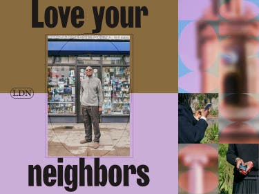 A man with sunglasses on standing in front of a local store with the label 'love your neighbors'.