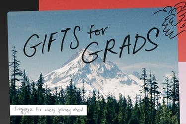 An image of snow covered mountains and pine trees with 'Gifts for Grads' and 'Luggage for every journey ahead' written on top.