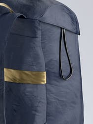 A zoomed in shot of a navy away packable backpack.