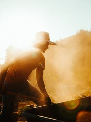 A man farming in the sun