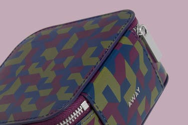 A close up detailed view of the new geometric print pattern of the Away Jewelry Box and other travel accessories