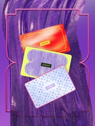 Three away gift cards on top of a purple backdrop design, each gift card with a unique design. One in red and yellow, one purple and yellow, and one baby blue with dark blue stars