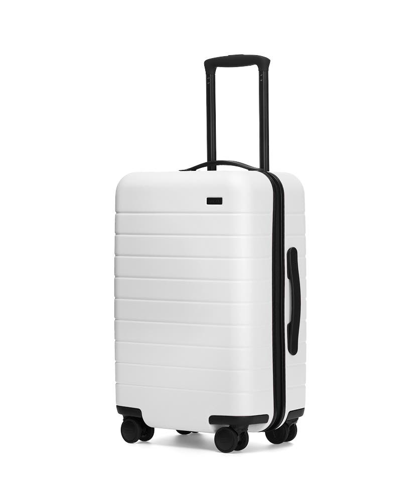 The Carry-On in White shown at an angle with raised telescoping handle
