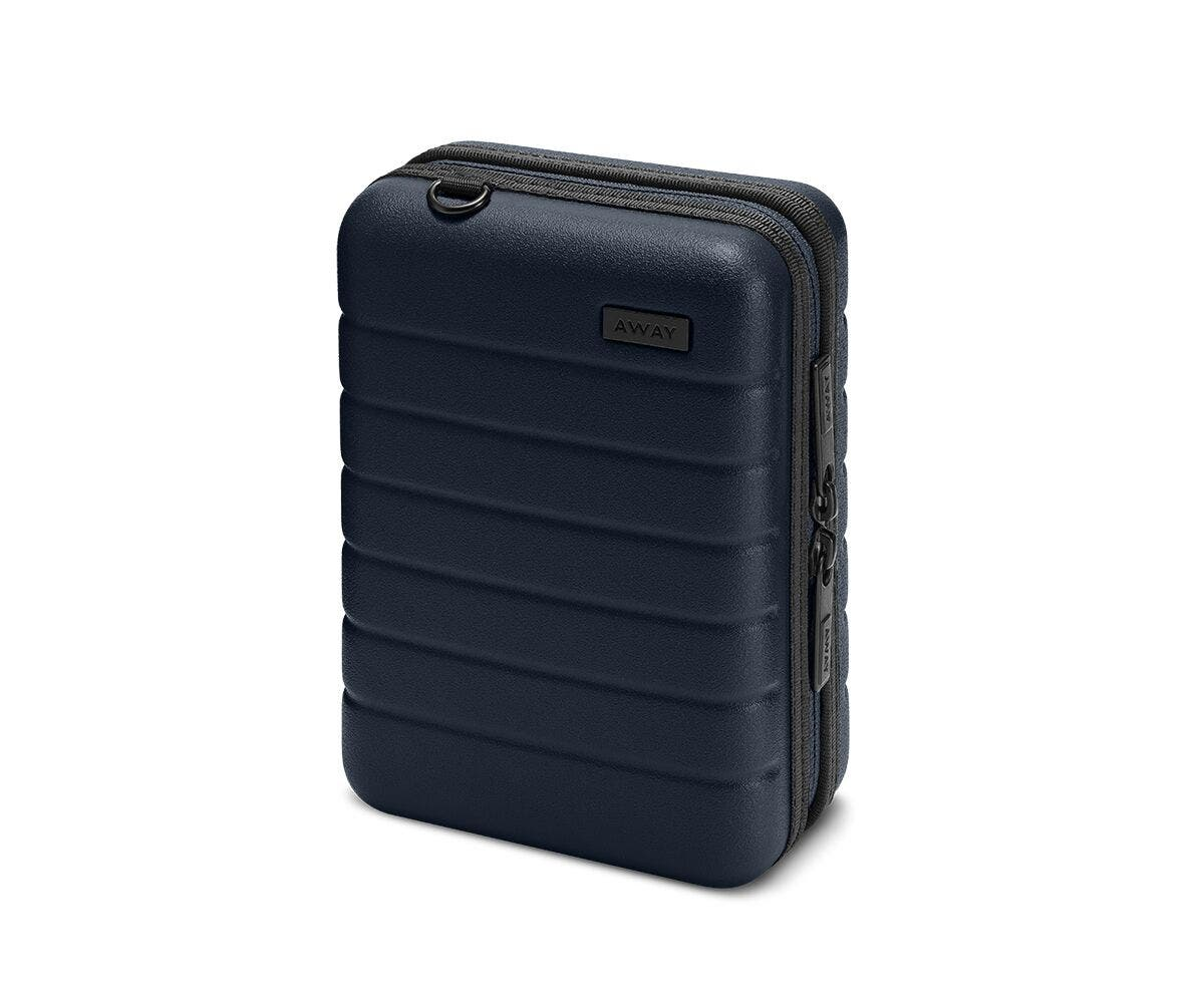 Hardsided mini suitcase displayed from the front in Navy.
