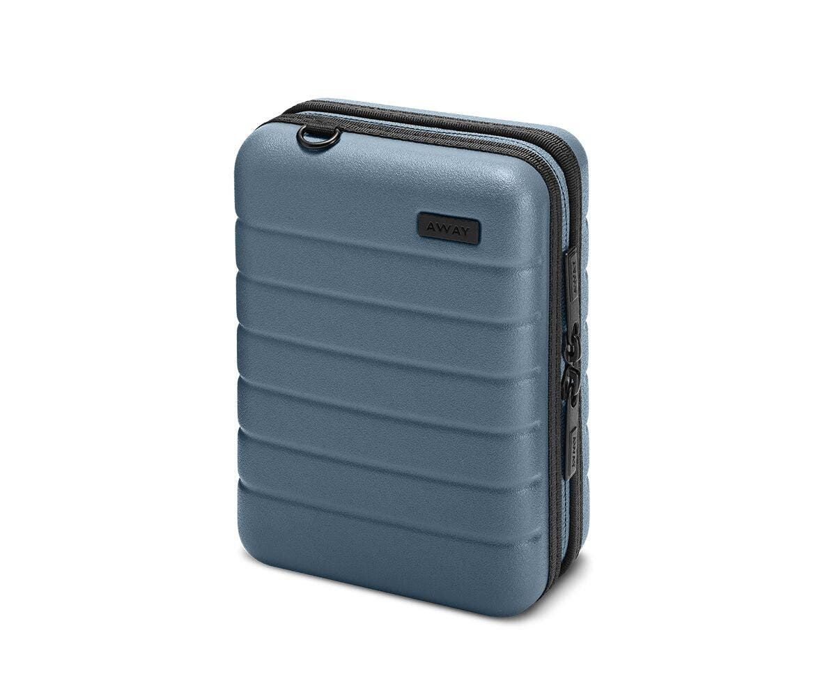Hardsided mini suitcase displayed from the front in Coast.