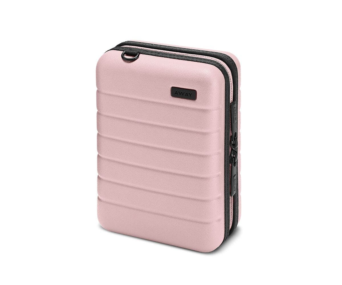 Hardsided mini suitcase displayed from the front in Blush.
