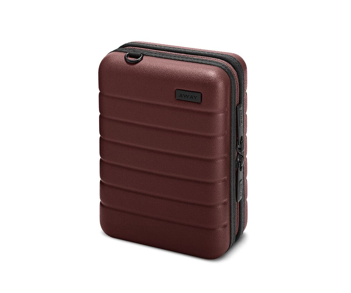 Hardsided mini suitcase displayed from the front in brick.