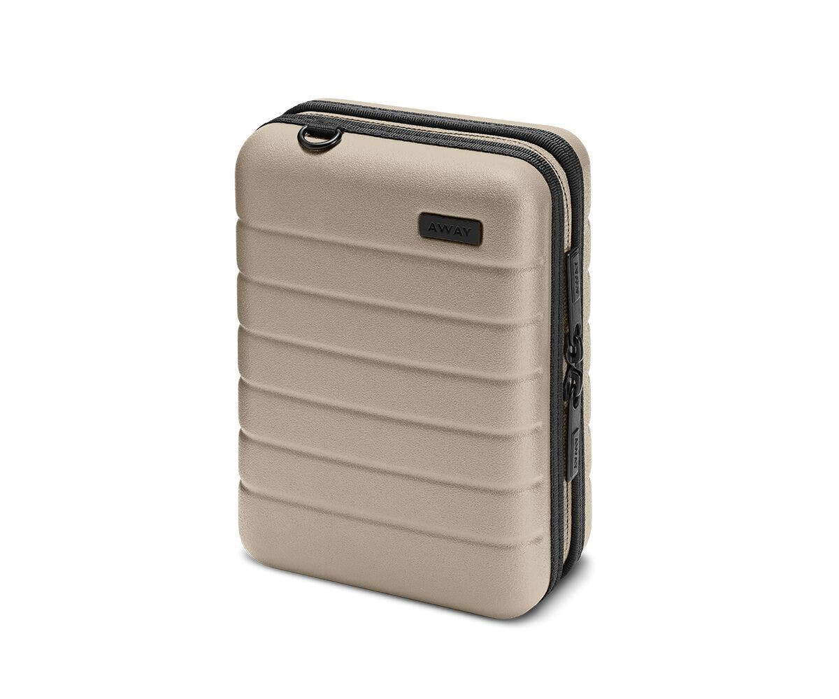 Hardsided mini suitcase displayed from the front in Sand.