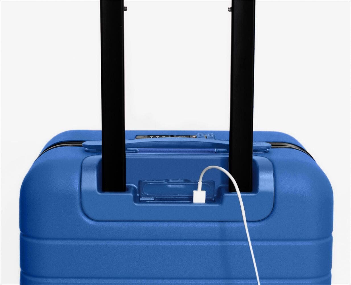 Video showing a finger pressing the battery to eject it from The Carry-On in Classic Blue