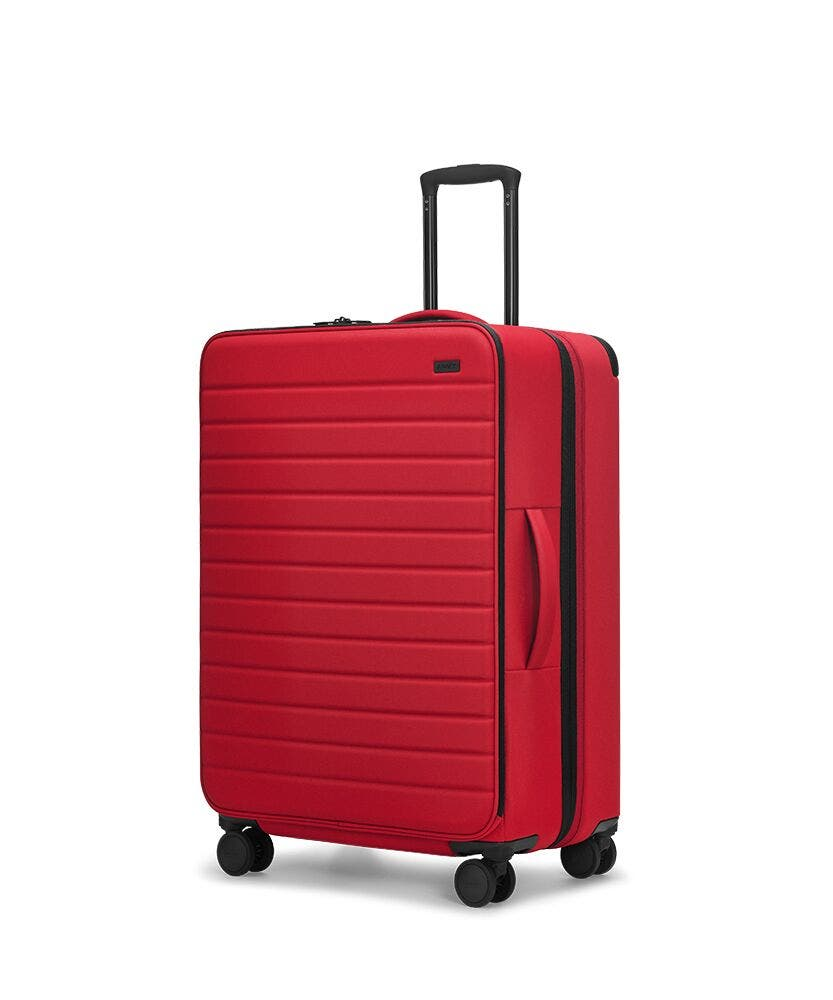 Red soft-sided Large with raised telescopic handles shown at an angle.