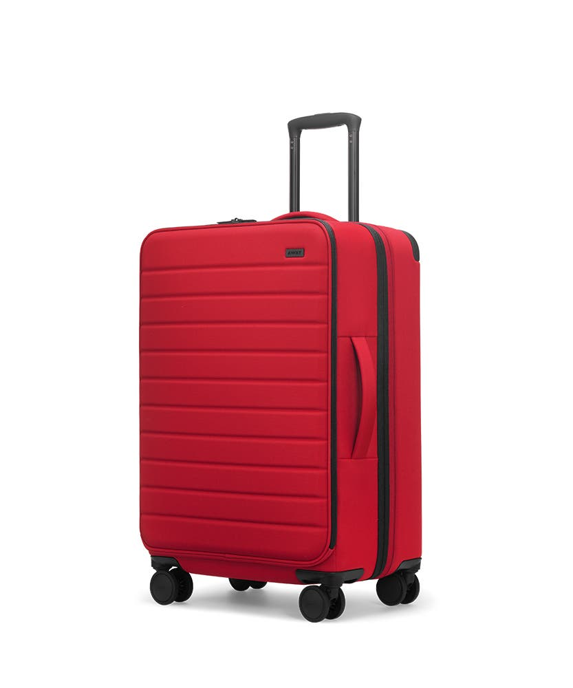 Red soft-sided Medium with raised telescopic handles shown at an angle.