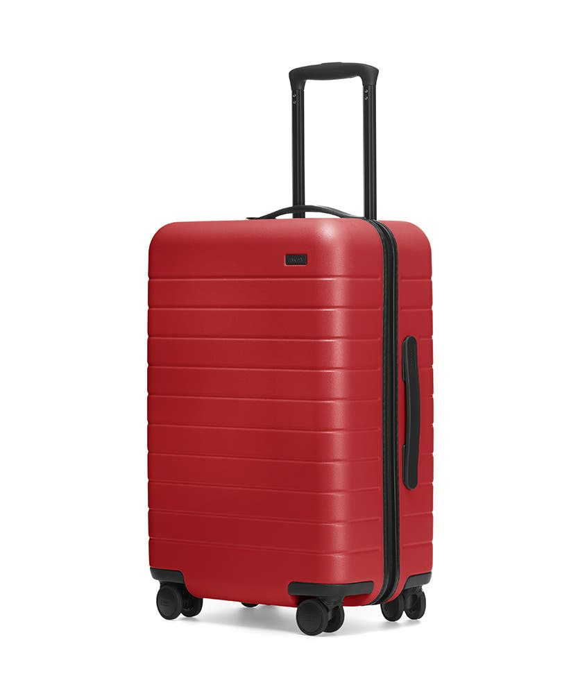 Red hardside Bigger Carry-On with raised telescopic handles shown at an angle.