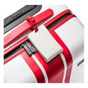 White and red small suitcase by Away with matching luggage tag and TSA approved locks.