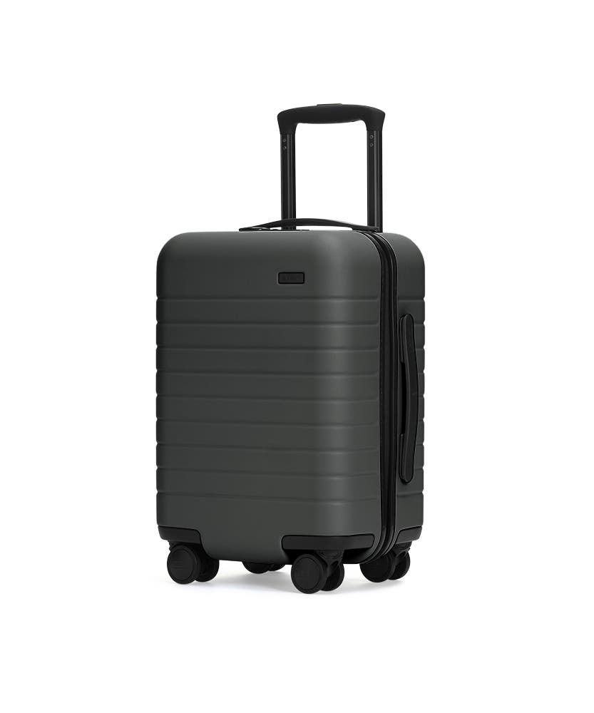 The Kids' Carry-On in Asphalt shown at an angle with raised telescoping handle