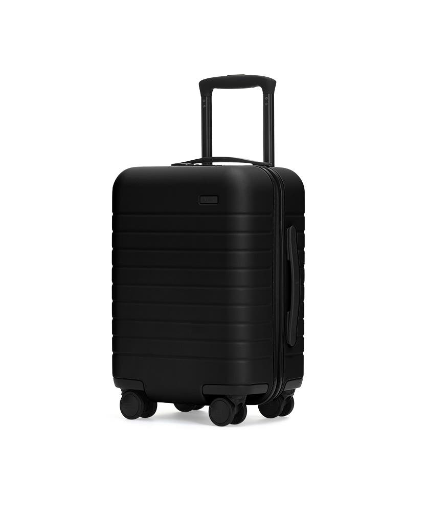 The Kids' Carry-On in Black shown at an angle with raised telescoping handle