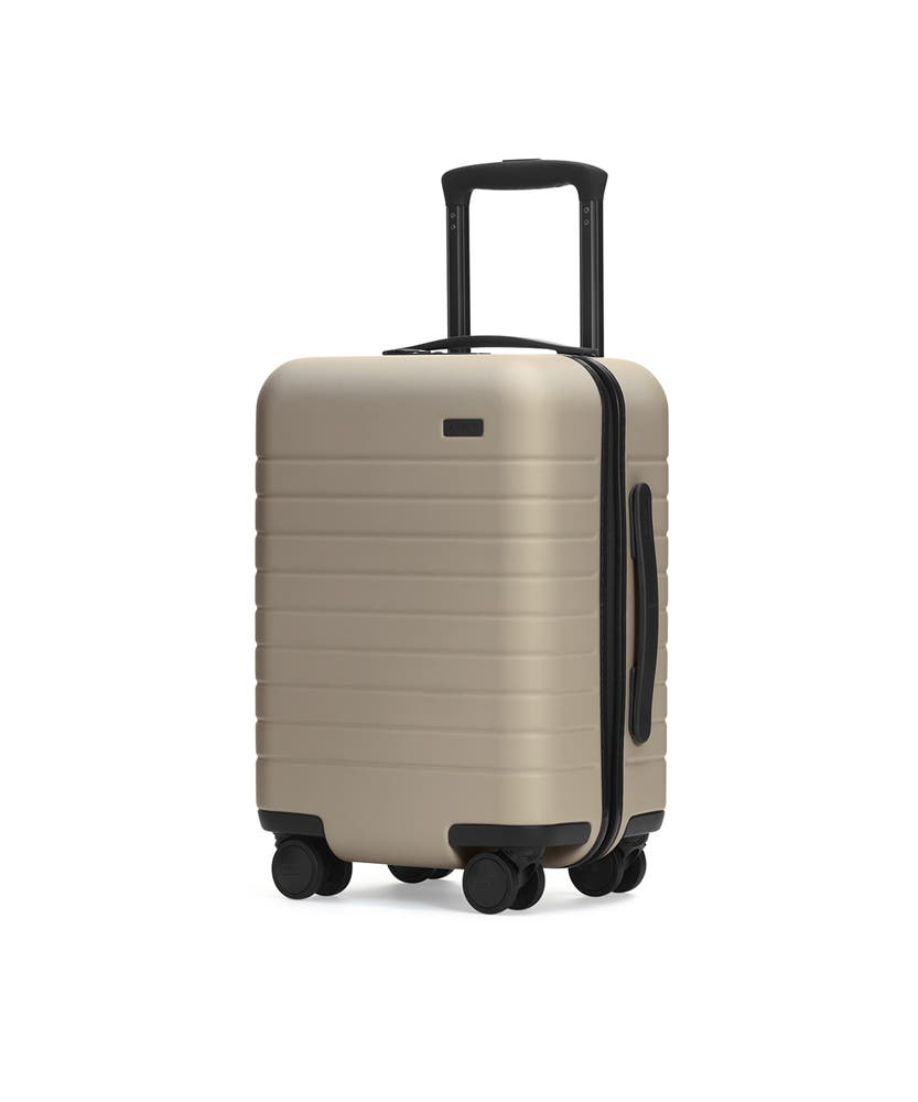The Kids' Carry-On in Sand shown at an angle with raised telescoping handle