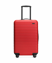 Front view of the Away Cherry Bigger Carry-On hardside showing raised handle.