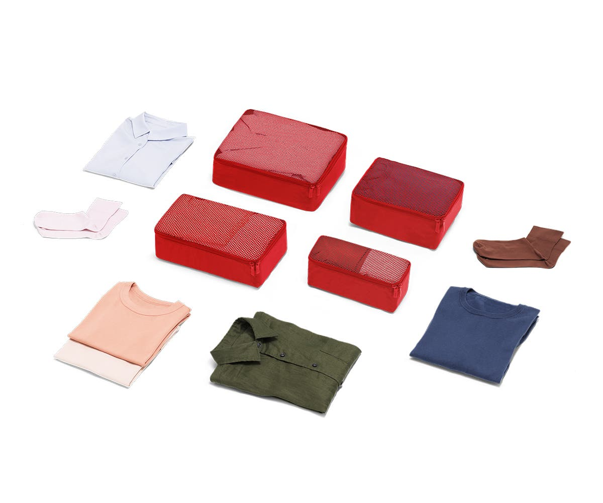 Set of four packing cubes in Cherry with clothes displayed around it