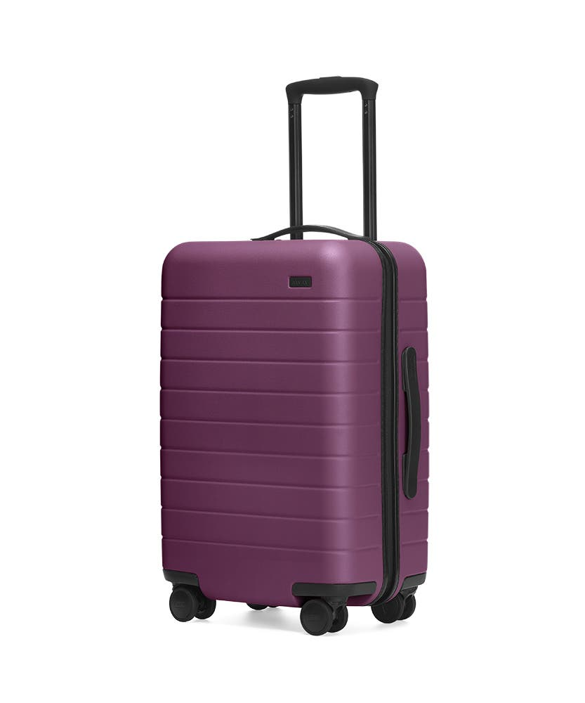 The Plum Carry-On hardside with raised telescopic handles shown at an angle.