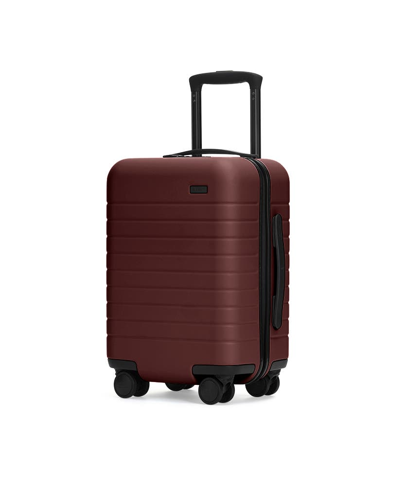 The Kids' Carry-On in Brick shown at an angle with raised telescoping handle