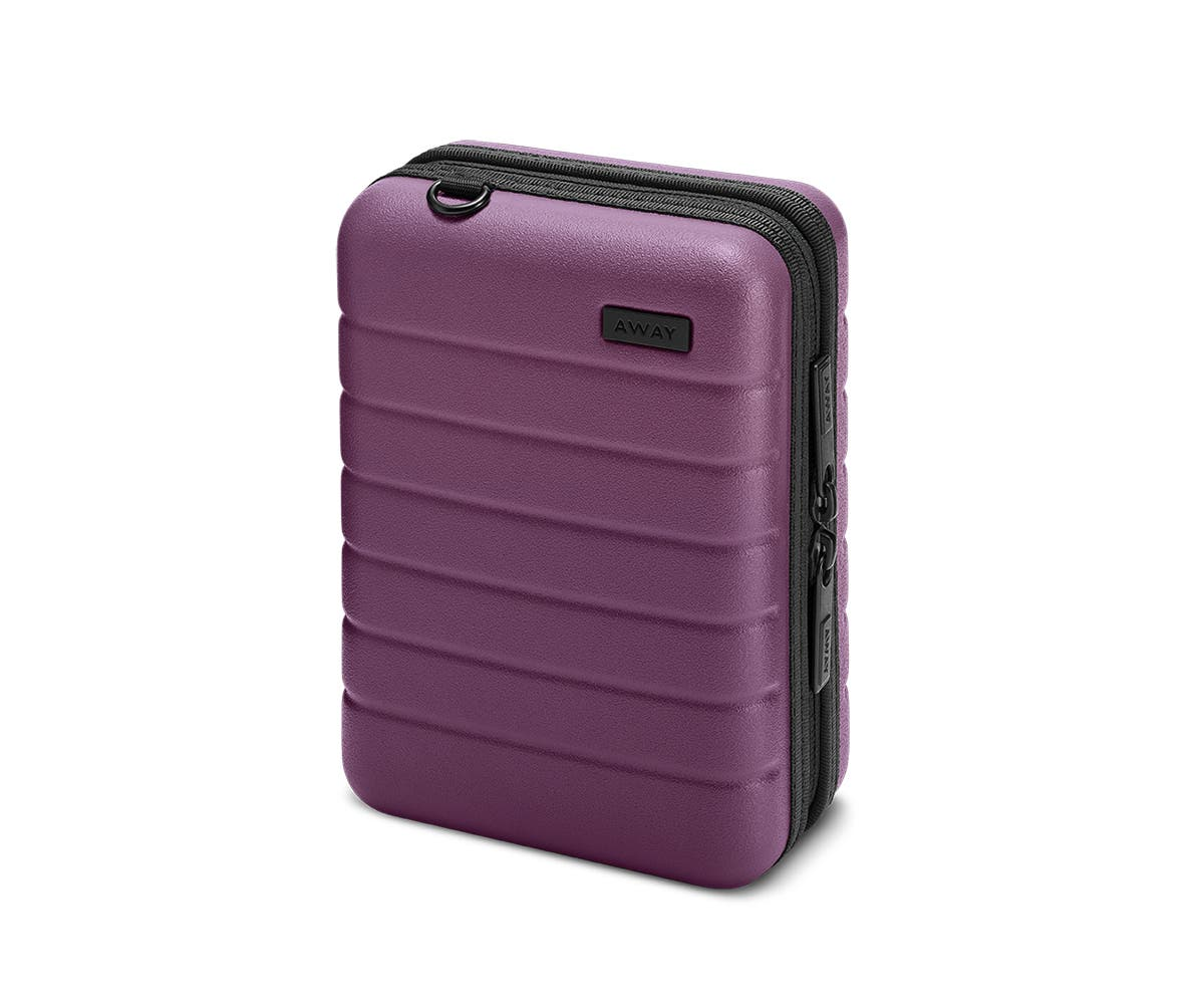 Hardsided mini suitcase displayed from the front in Plum.