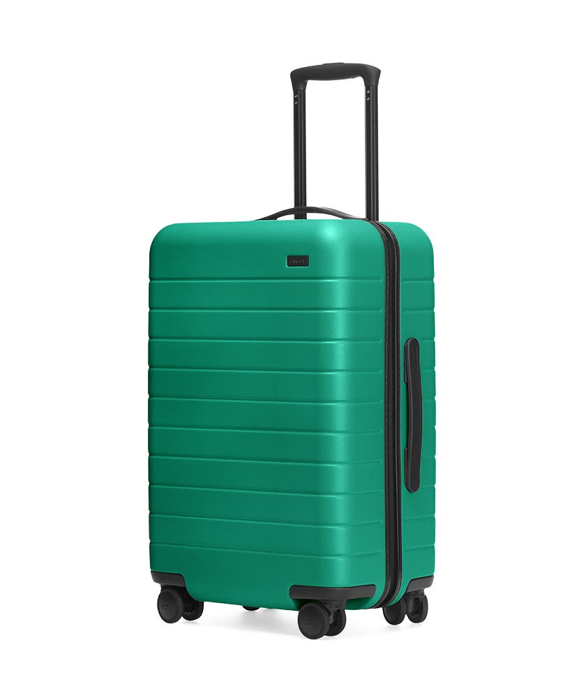 The Sea-green Bigger Carry-On hardside with raised telescopic handles shown at an angle.