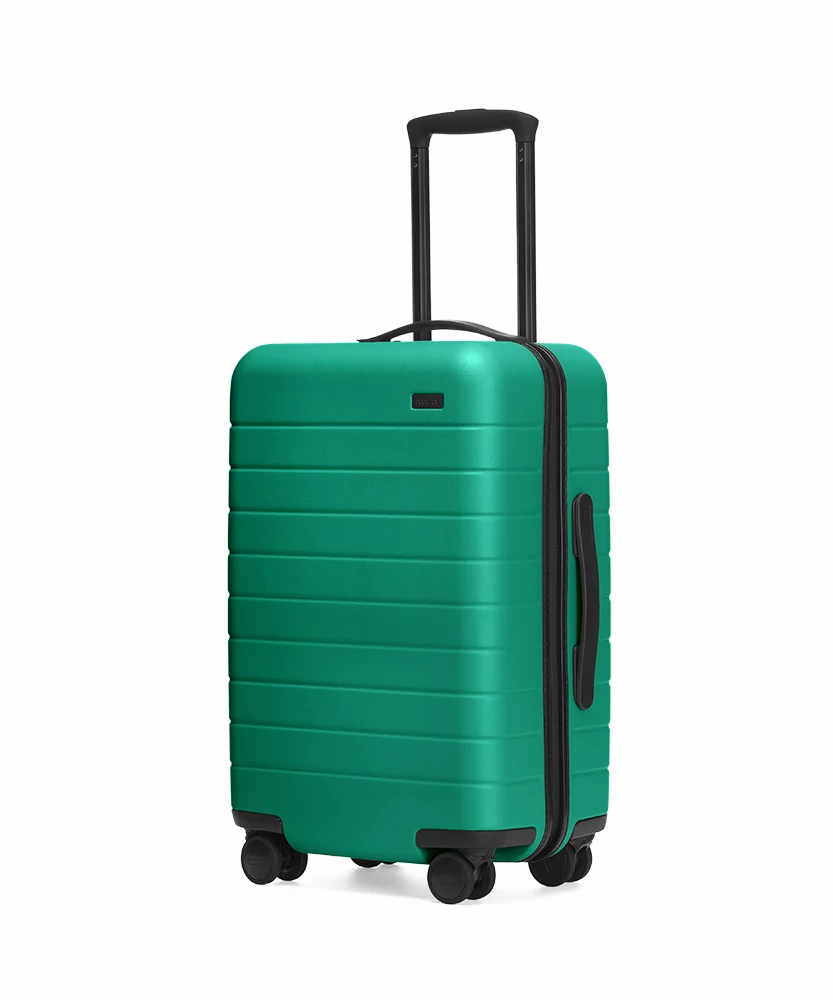 The Sea-green Carry-On hardside with raised telescopic handles shown at an angle.