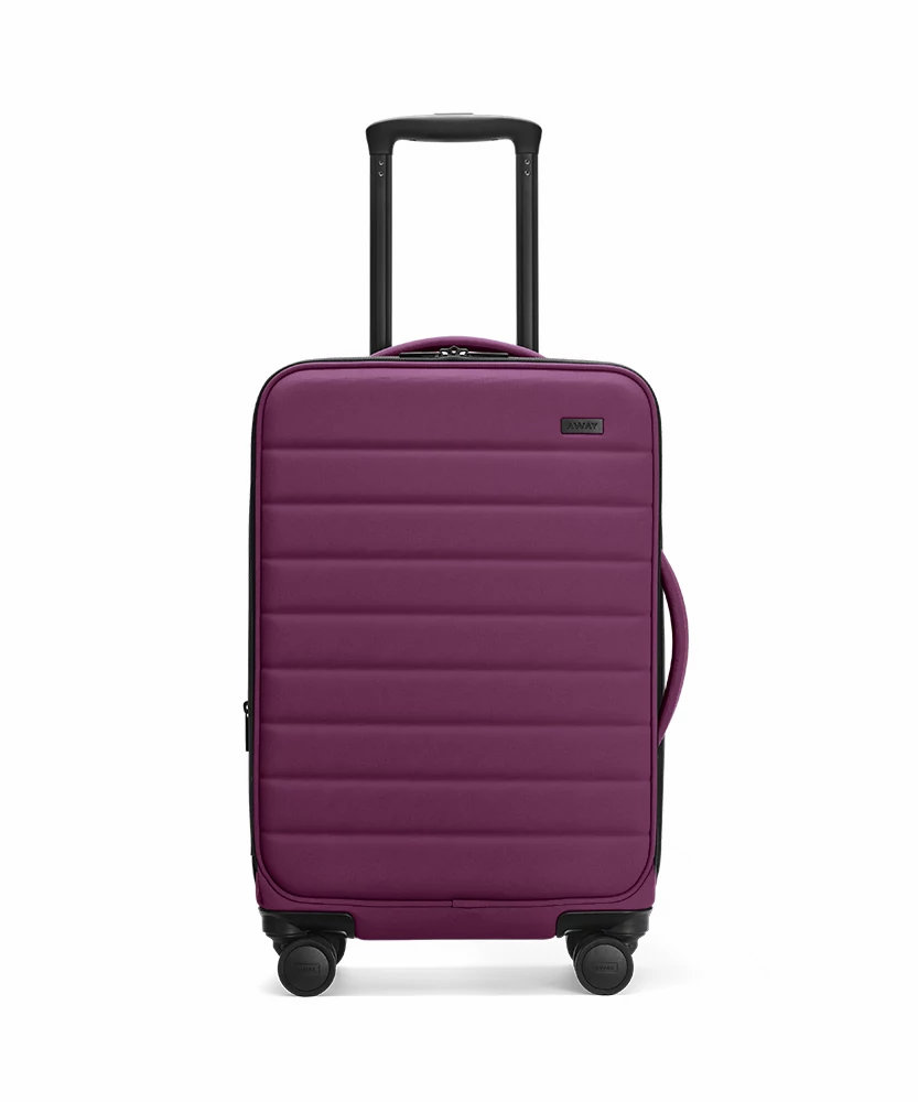 Front view of the Away Plum Expandable Carry-On softside showing raised handle.