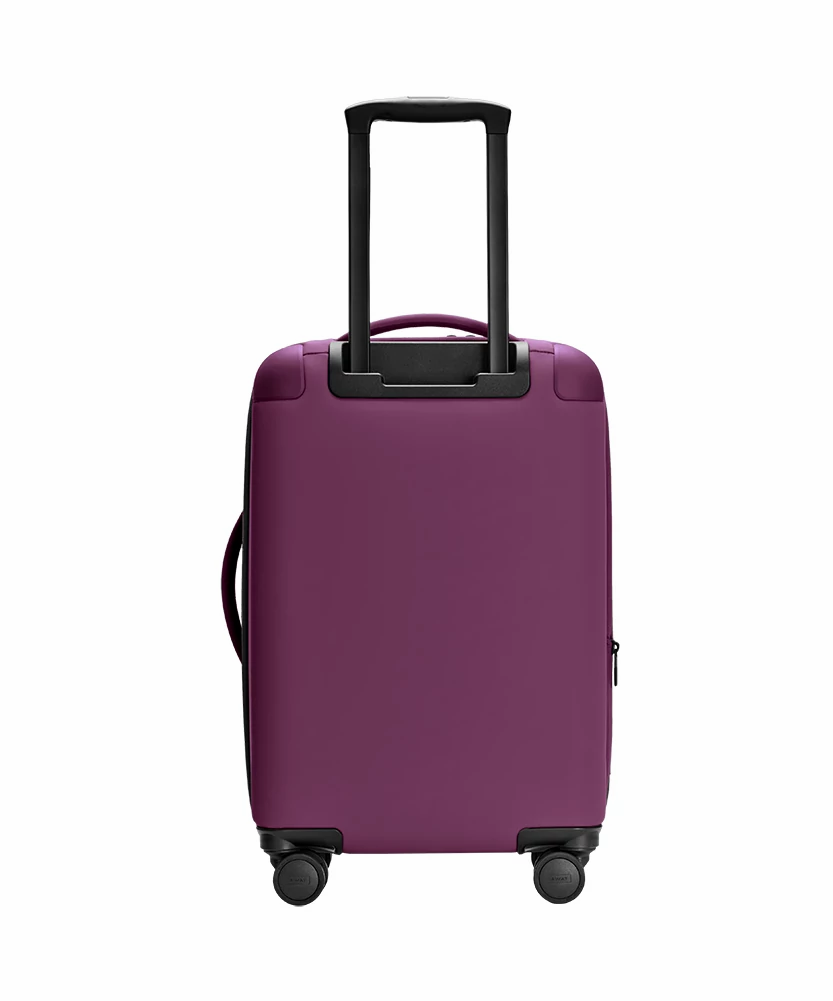 Back view of the Away Plum Expandable Carry-On soft shell with raised handle.