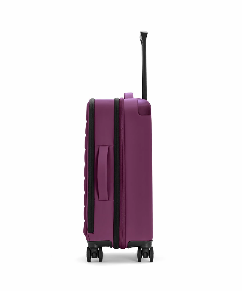 Side view of the Plum Expandable Carry-On soft suitcase showing zip and handle.