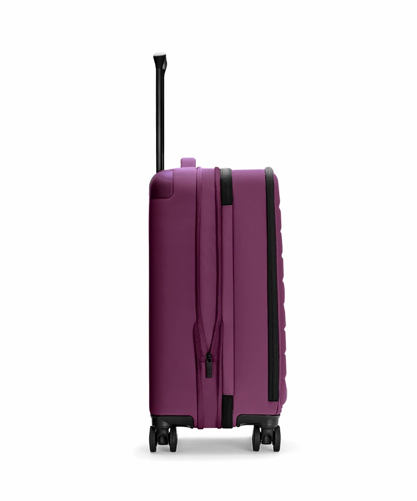 Expanded side view of the Plum Expandable Carry-On soft suitcase showing zip and handle.