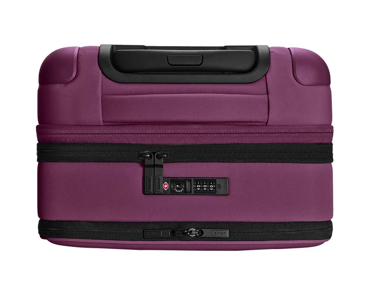 Close TSA approved lock-view of the Away Expandable Carry-On soft side in the color Plum.
