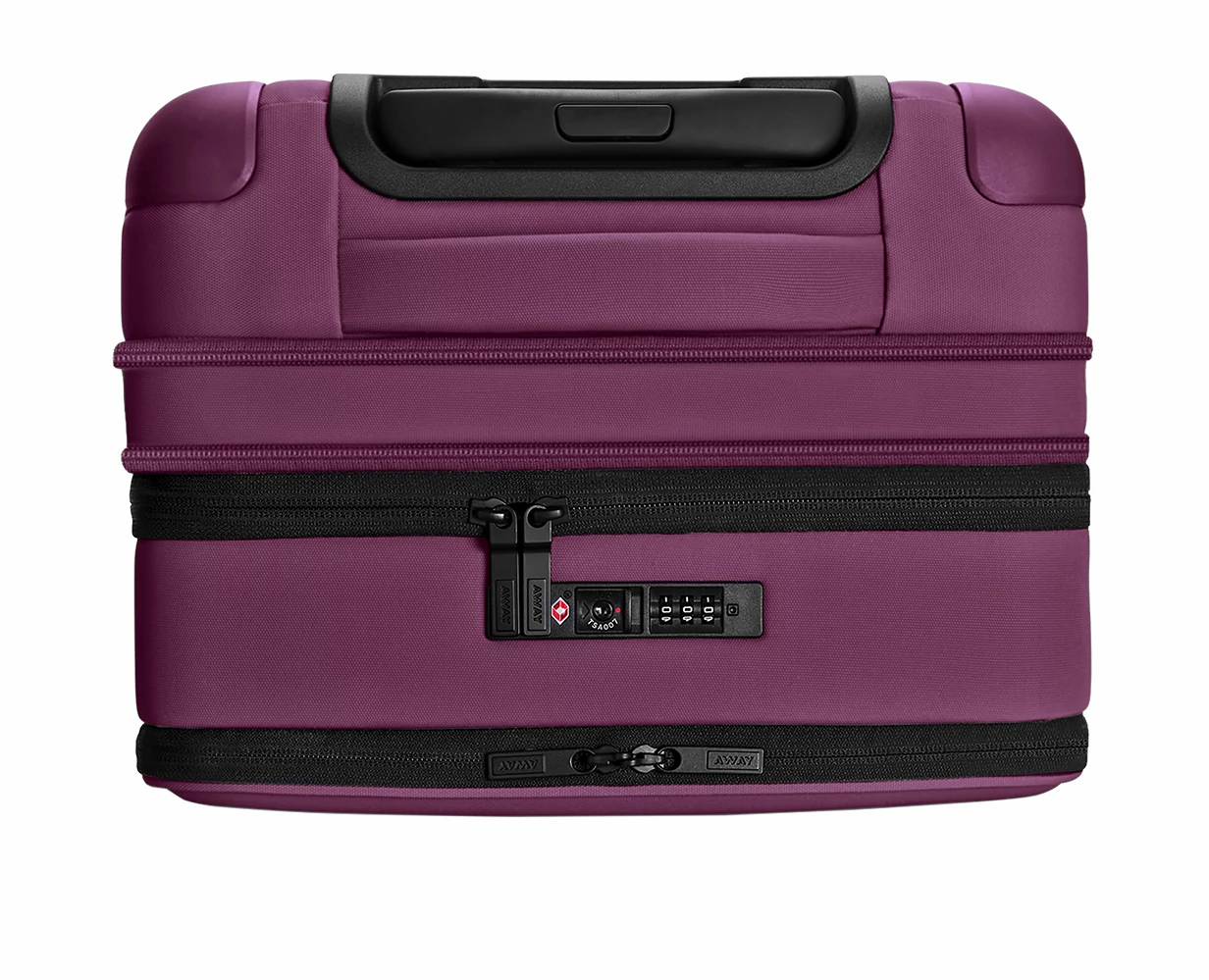 Close TSA approved lock-view of the Away Expandable Carry-On soft side in the color Plum, expanded.