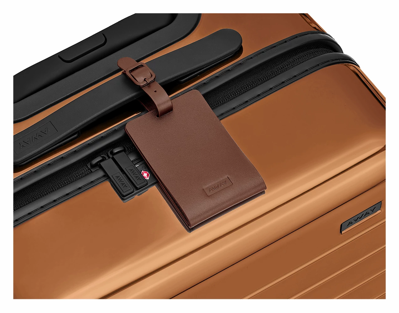Brown leather luggage tag shown on handle of Copper hard suitcase.