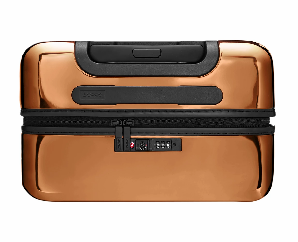 Close TSA approved lock-view of the Away Bigger Carry-On PC in the color Copper.
