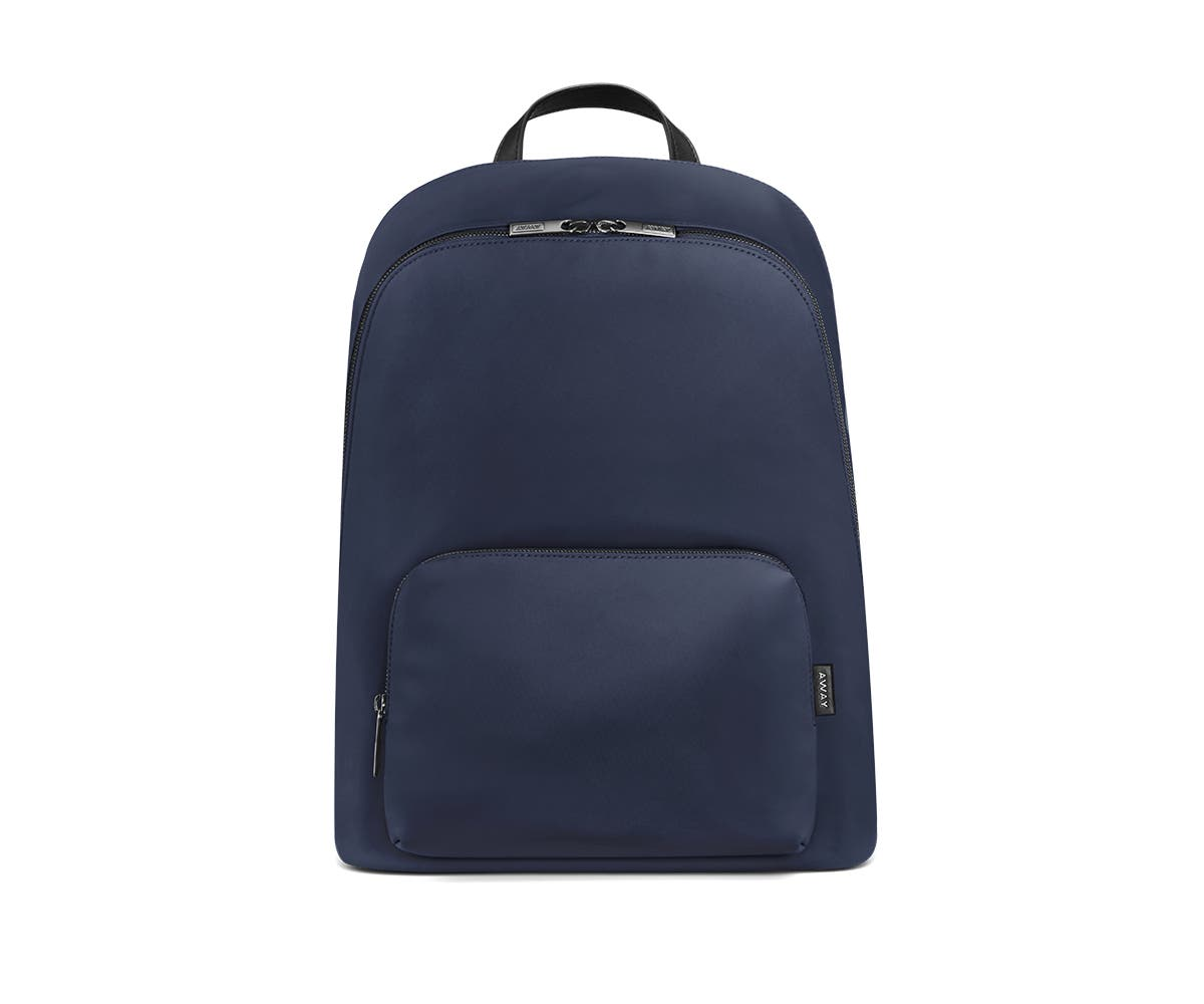 Front of a navy backpack with two pockets one main and one small with zip.