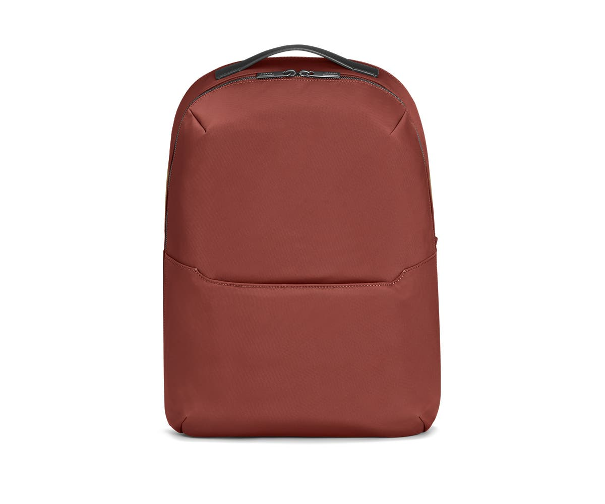 Front view of a red backpack.