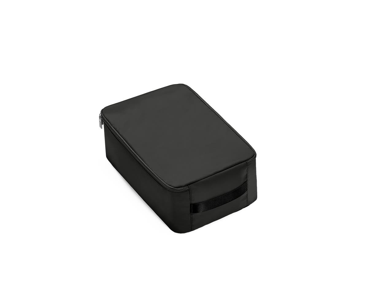 A angled view of a small black shoe cube.