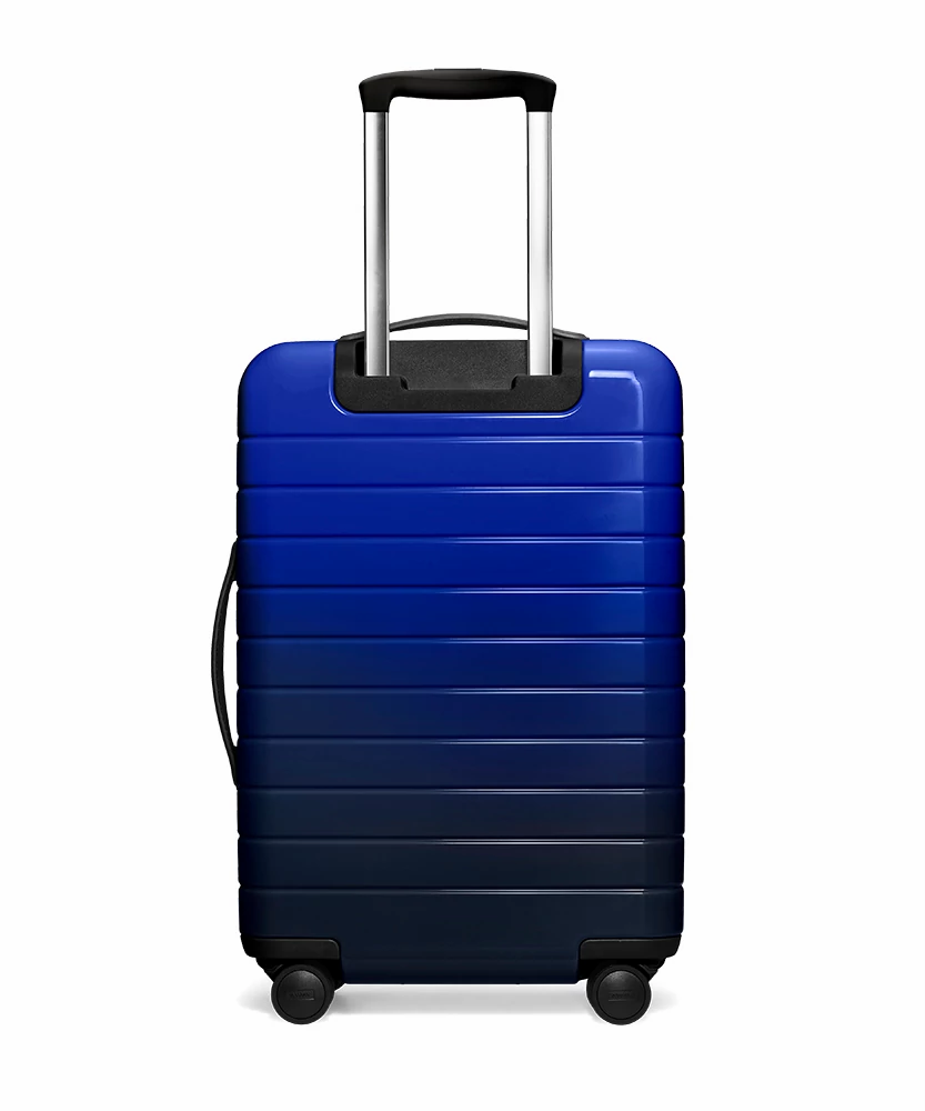 Back view of the Away Nightfall Ombre Bigger Carry-On hardside showing raised handle.