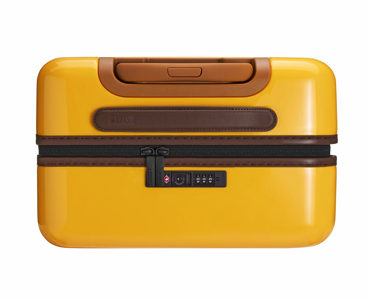 Close TSA approved lock-view of the Away Carry-On PC in the color Golden Ombre.