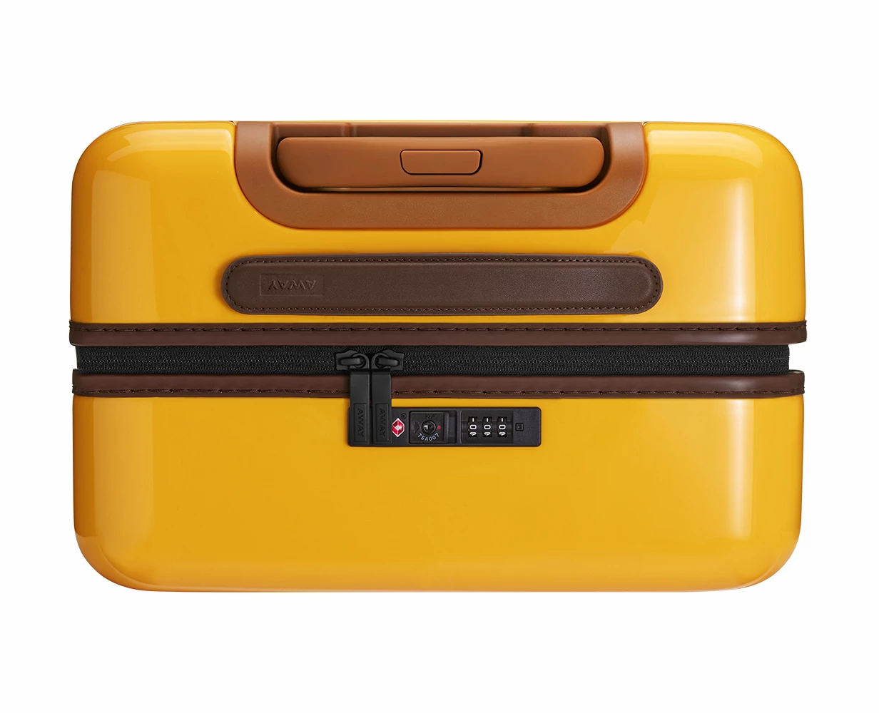 Close TSA approved lock-view of the Away Bigger Carry-On PC in the color Golden Ombre.