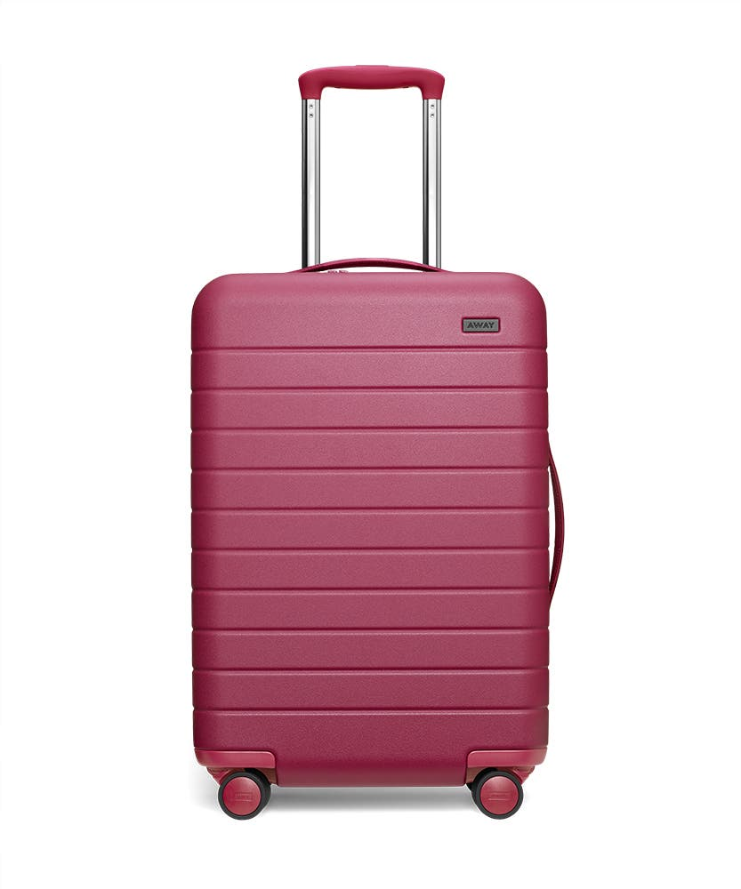 Front view of the Away Bigger Carry-On Plum Matte hardside showing raised handle.
