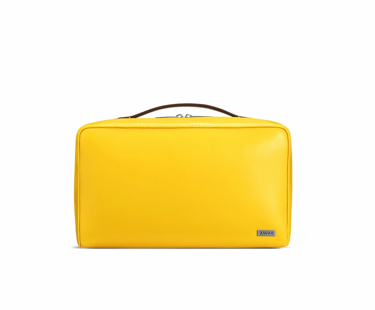 Large travel toiletry bag in the color golden yellow.