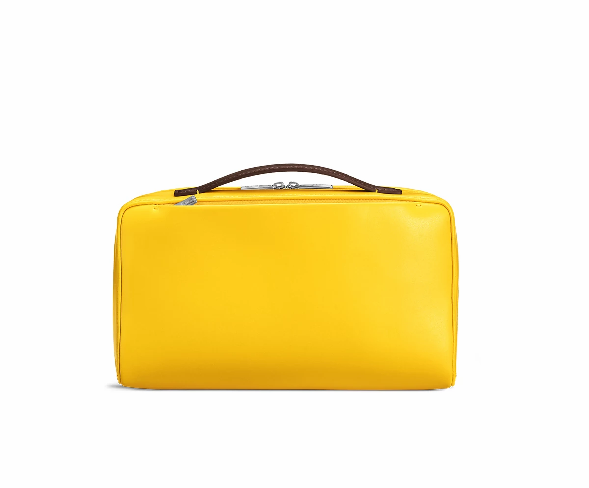 Back view of a travel toiletry kit in golden yellow.