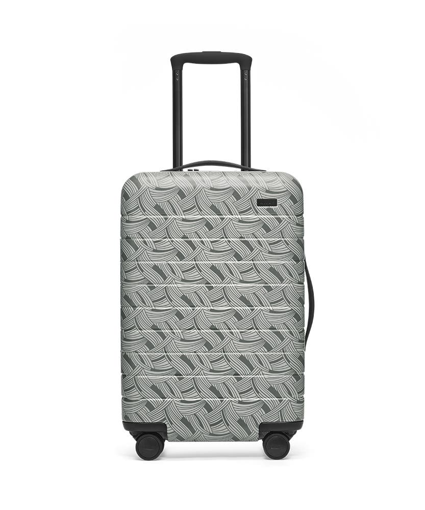 Front view of the Away Light Swirl Carry-On hardside showing raised handle.