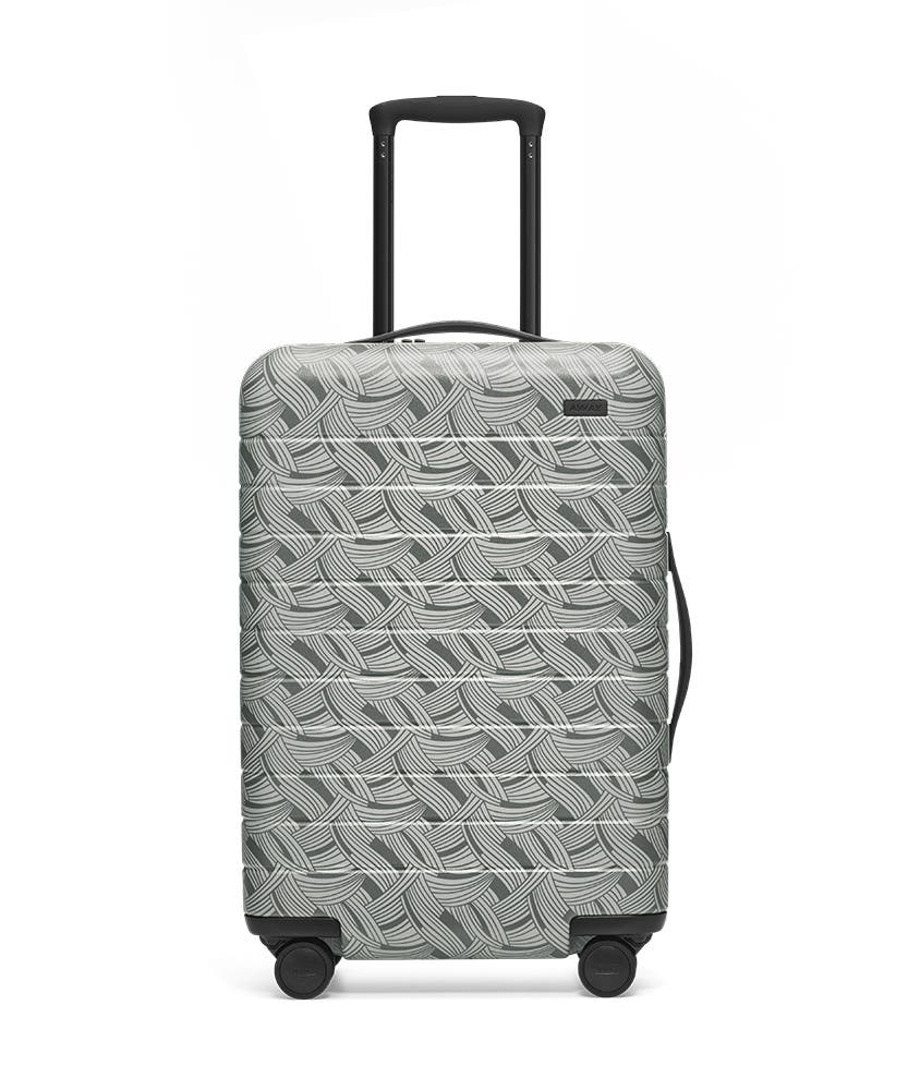 Front view of the Away Light Swirl Bigger Carry-On hardside showing raised handle.