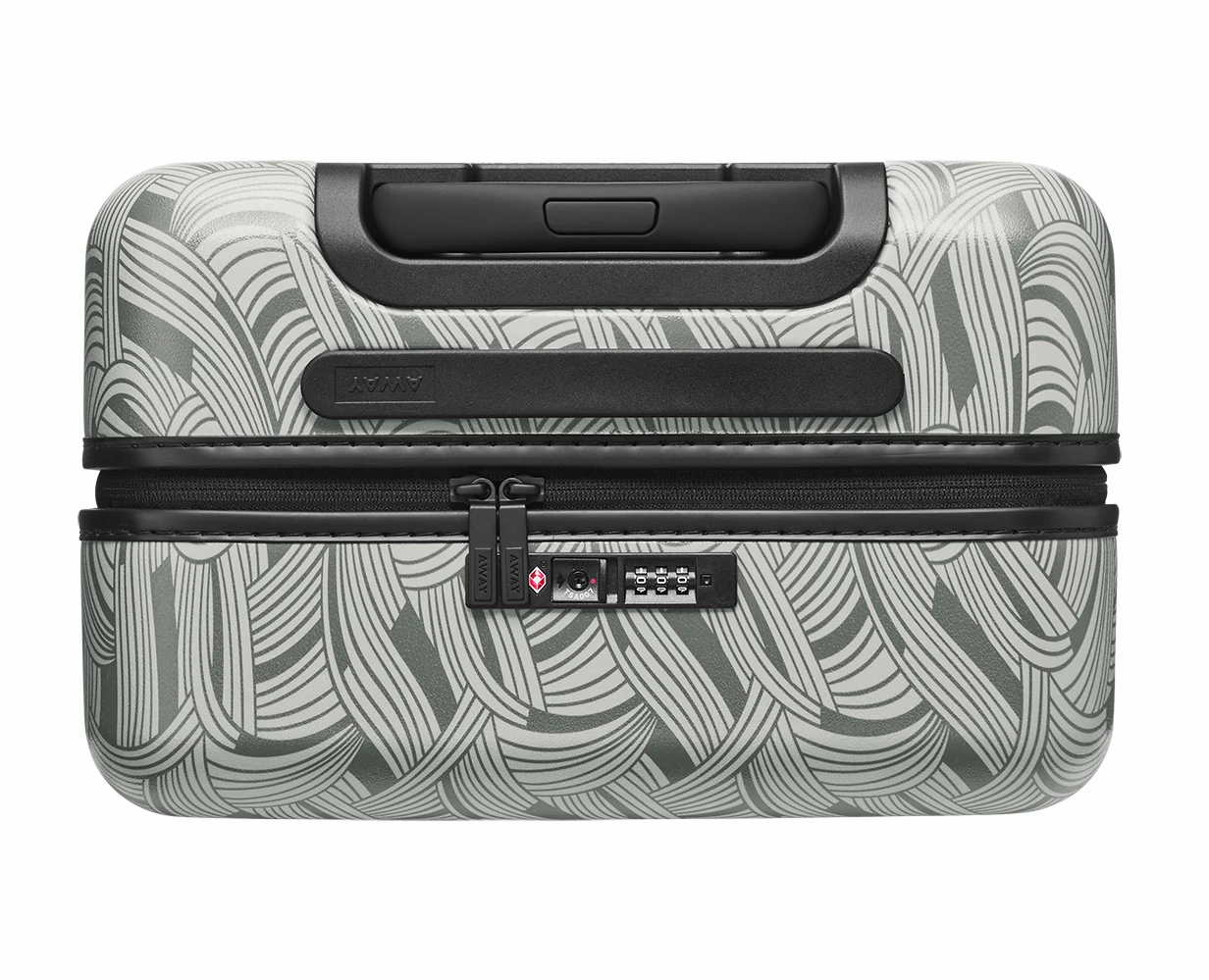 Close TSA approved lock-view of the Away Bigger Carry-On PC in the color Light Swirl.