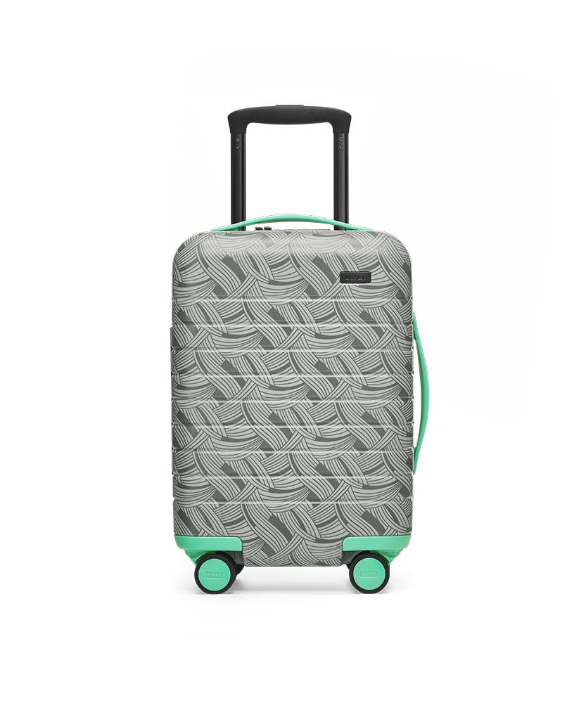 Front view of the Away Kids' Carry On Light Swirl hardside showing raised handle.