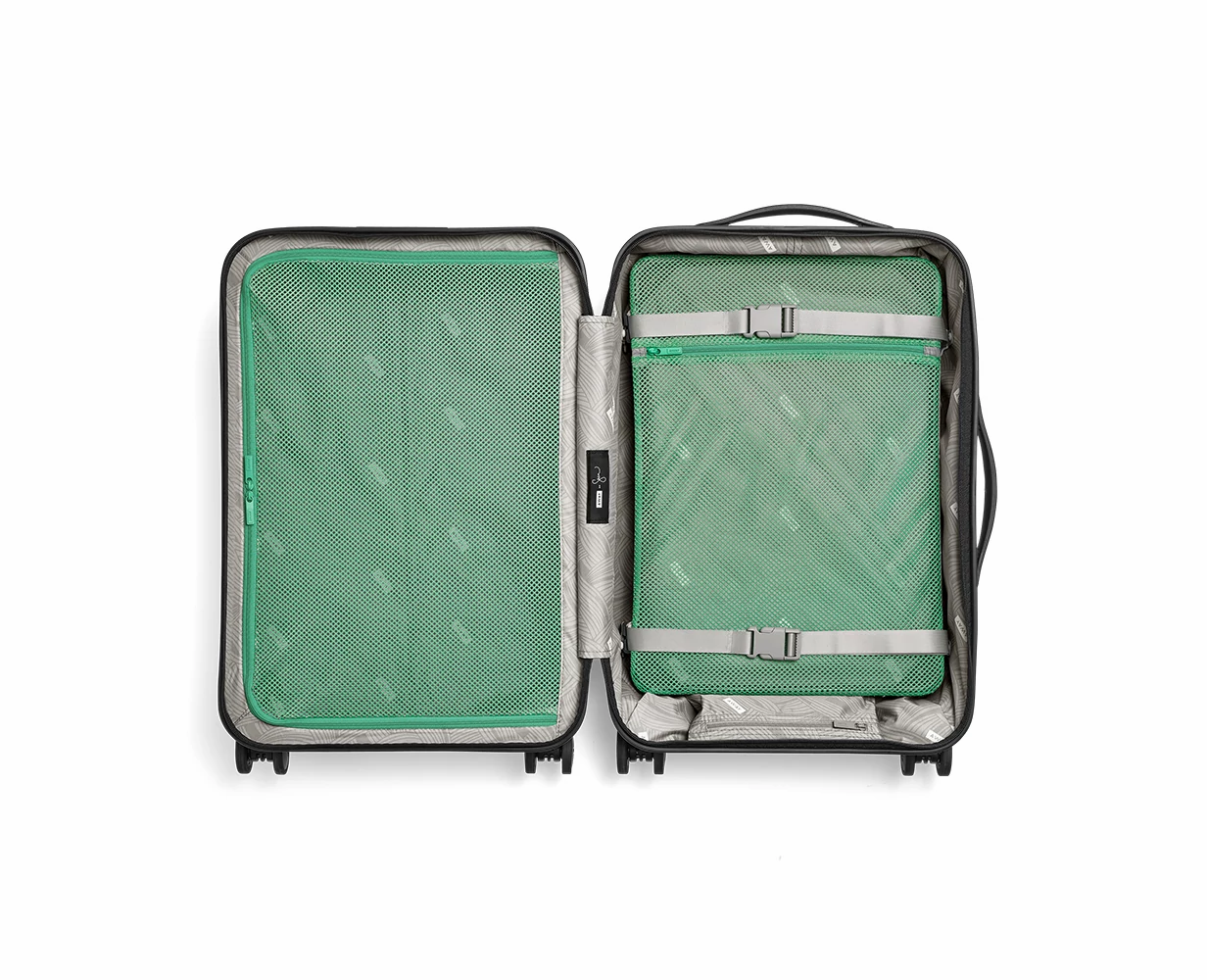 Bigger Carry-On in Light-Swirl shown open with interior compression pad on the right