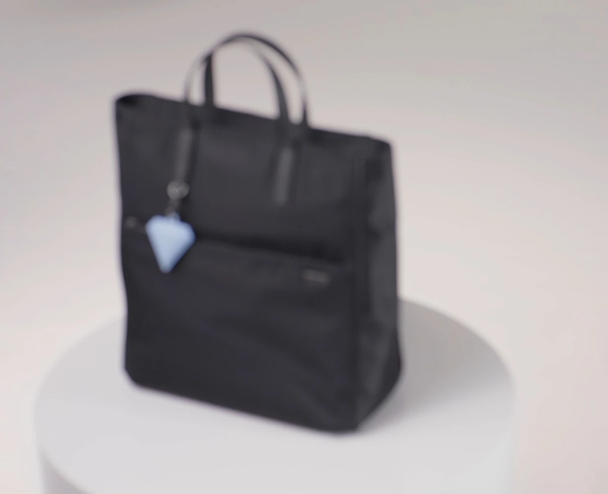Video showing versatile functionality of The Convertible Backpack Tote, showing convertible straps being tucked away to carry as either a tote or a backpack